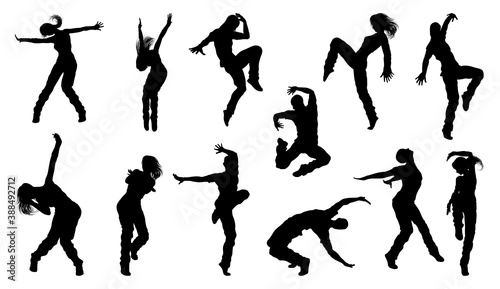 A set of men and women street dance hip hop dancers in silhouette Canvas Print
