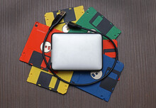 Colorful Floppy Disks With Hard Drive On Top