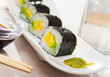 Tasty Maki roll with avocado served on plate with sauce