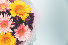 Gerbera Bouquet On A Blue Background. Great Background For Design