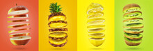 Panoramic Image Of Sliced Fruits Levitating In The Air. Set Of Fresh Fruits On Colorful Backgrounds.