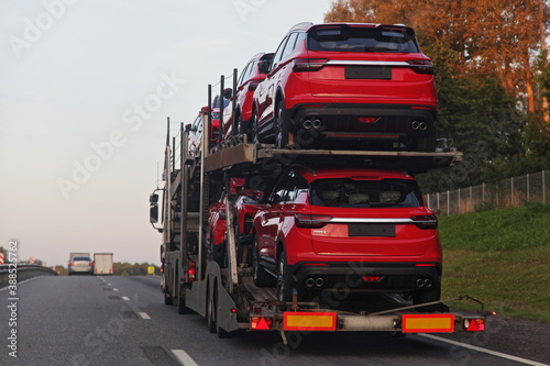 Loaded two level car carrier truck with car transporter semi trailer transportat Fototapet