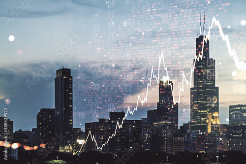 Double exposure of abstract creative financial chart hologram and world map on Chicago city skyscrapers background, research and strategy concept