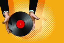Male Hands Gently Hold A Retro Vinyl Record With A Red Label In The Center
