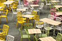 Empty Chairs And Tables In An ...