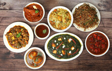 Assorted Indian Food On Wooden...