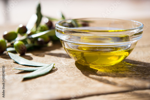 olive extra Virgin oil in glass transparent bowls on the wooden background in sunlights Fototapet