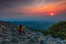 Young  Woman Hiking On Mountains. Lan-hin-pum, Phu Hin Rong Kla National Park, Phitsanulok Province , Thailand.