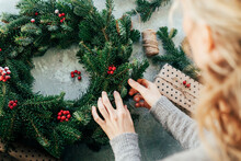 Woman Makes A Fir Wreath For A...
