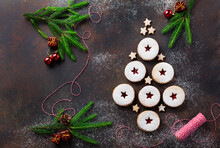 Traditional Christmas Linzer Cookies With Raspberry Jam On Dark Background.