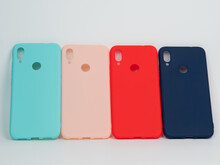 Colorful Plastic Phone Cases On White Background