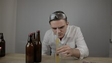 Young Master Technologist Brews Beer At Home, Pours Beer Into Bottles, Checks The Sugar Level In Beer, Checks The Percentage Of Alcohol In Beer, Checks The Quality Of The Brewed