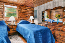 Log Cabin Bedroom With Lamps