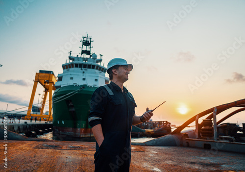 Fotomural Marine Deck Officer or Chief mate on deck of offshore vessel or ship , wearing PPE personal protective equipment - helmet, coverall