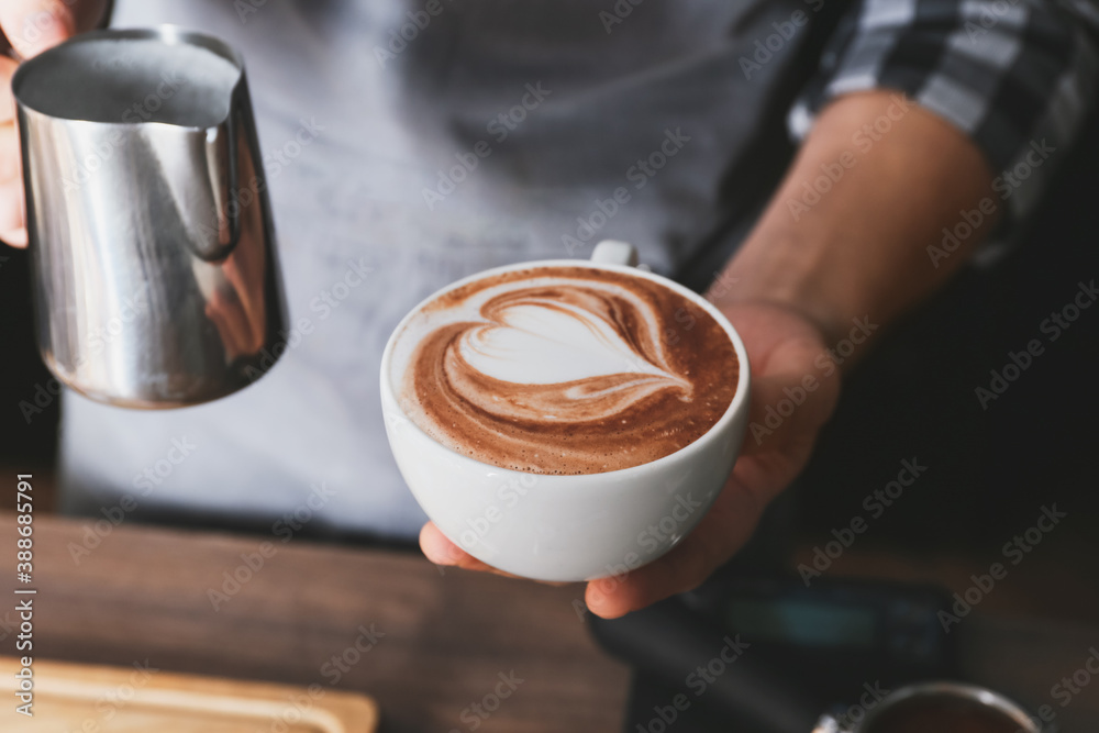 Fototapeta Barista making hot coffee in cafe, closeup
