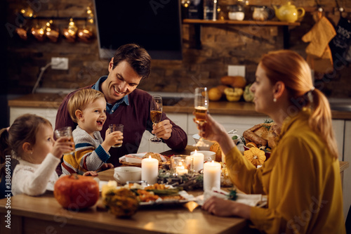 Happy family having fun during Thanksgiving dinner at dining table Fototapete