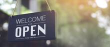 Welcome Open Sign On Shop Door. Text On Cafe Front Or Restaurant Hang On Door At Entrance. Vintage Tone Style. Banner.