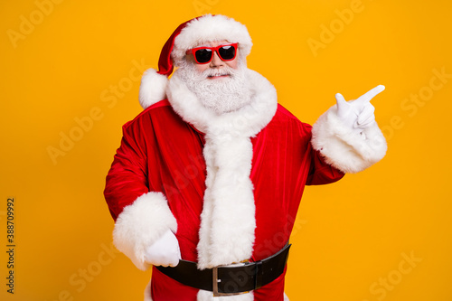 Obraz Portrait of his he nice attractive cheerful cheery fat Santa father demonstrating copy space advert newyear celebratory day isolated over bright vivid shine vibrant yellow color background - fototapety do salonu