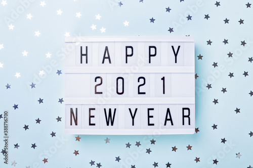 Obraz Lightbox with text HAPPY NEW YEAR 2021 on blue background. Top view. New year celebration. Happy New Year 2021 concepts - fototapety do salonu