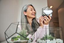 Beautiful Joyful Woman Holding Geometric Glass Succulent Terrarium