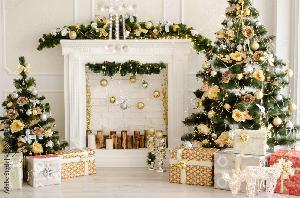 Fototapeta Christmas decorated interior - bright room with fir-tree, gift boxes, fireplace decorated with garlands - New Year celebration photo