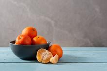 Fresh Tangerines In Bowl On Bl...