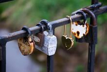 Close Up Of Rusty Love Locks On The Bridge