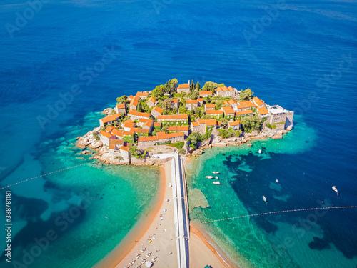 Obraz Famous Sveti Stefan island in Budva during a summer day, Montenegro. Drone aerial photo - fototapety do salonu