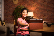 Asian Indian Cute Little Girl Learning Music At Home Attending Online Class On Laptop Or Tablet Pc