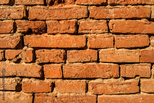 Foto Old weathered grunge brick masonry wall closup as brick background