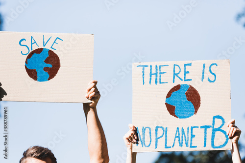cropped view of volunteers holding placards with globe and there is no planet b Fotobehang