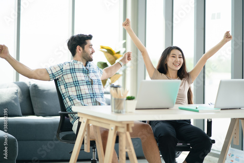Happy young couple work from home which have great time together and look success for work, Life style of young generation domestic life Billede på lærred