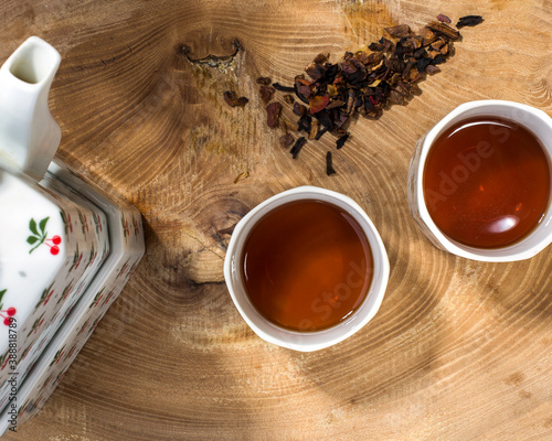Tela two cups o tea  on wooden surface