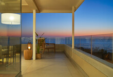 Scenic Ocean View On Luxury Home Showcase Balcony At Dusk