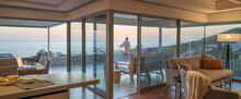 Woman Enjoying Scenic Sunset Ocean View On Luxury Balcony