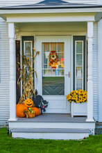 Front Door To A Home Decorated For Halloween To Welcome  Trick Or Treaters