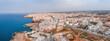 Aerial panoramic cityscape of Polignano a Mare town, Puglia region, Italy near Bari city, Europe. Superb scenic view of Adriatic sea. Traveling concept background.