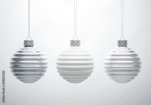 Foto Black and white composition of three horizontally ribbed Christmas balls hanging in line