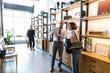Optometrist Helping Customer Choose Eyeglasses In Optical Shop