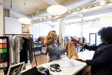Female Shop Owner Giving Shopp...