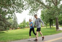 Mature Couple Jogging On Path ...