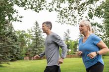 Healthy Mature Couple Jogging ...