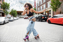 Cool Woman Roller Skating On C...