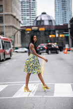 Portrait Confident Stylish Woman In Skirt And High Heels In Crosswalk