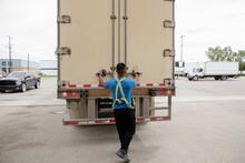Trucker Opening Container Doors Of Semi Truck