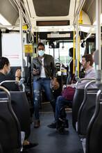 Female Passenger In Face Mask Boarding Public Bus