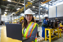 Female Transit Manager With Laptop In Maintenance Facility