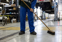 Male Transit Worker Sweeping F...