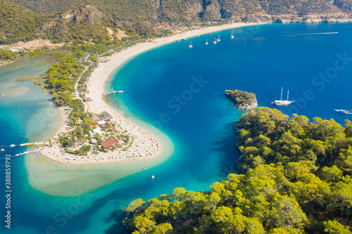 Obraz aerial view to curved coast and long sand beach near Fethie city in Turkey  - fototapety do salonu