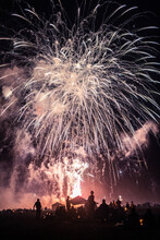 Large Fireworks Display Over A Crowd Of Anonymous People